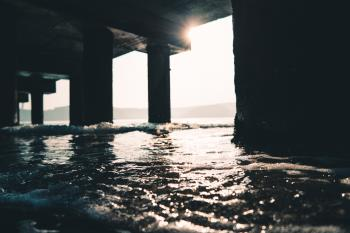 Photography of Sea Water Under The Dock