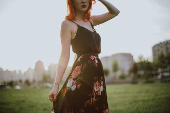 Photography of Woman in Black Spaghetti Strap Dress