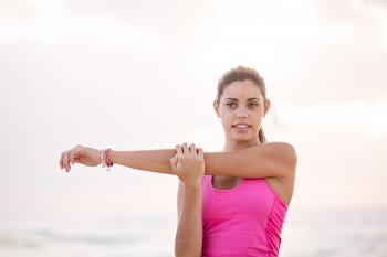 Photography of Woman in Pink Tank Top Stretching Arm