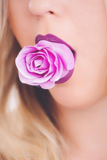 Pink Rose Flower on Woman's Mouth