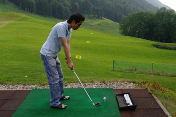 Player practicing golf
