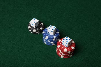 Poker chips and dice.