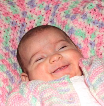 Portrait of a happy baby smiling
