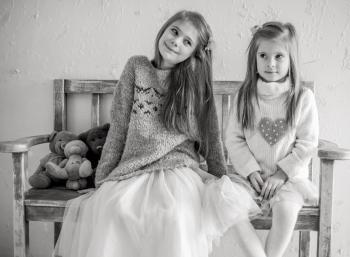 Portrait of Happy Girls Sitting