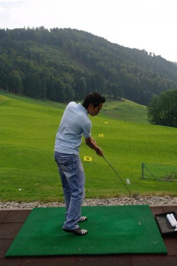 Practicing golf