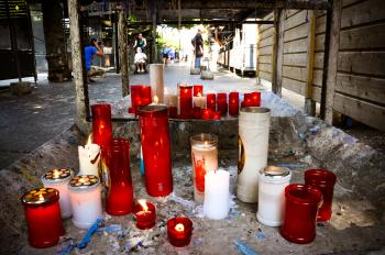 Prayer candles burning in lourdes