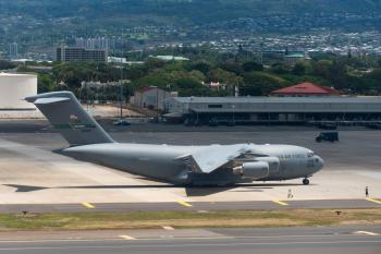 Profile view of U.S. Air Force jet on tarmac at Joint Base Pearl Harbor-Hickam