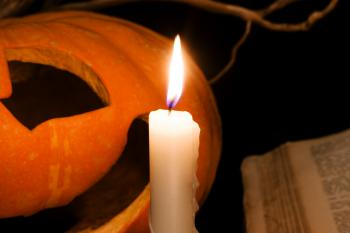 Pumpkin and candle