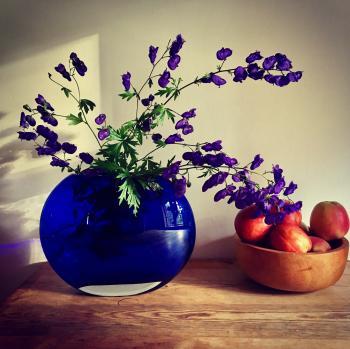 Purple Petaled Flower Arrangement Near Apple Fruit on Table