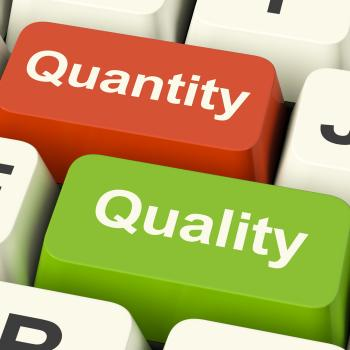 Quality And Quantity Computer Keys Showing Choice Between Excellence O