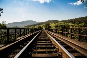 Railroad Tracks in Scenic Landscape