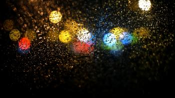 Raindrops on Road Seen Through Car Window