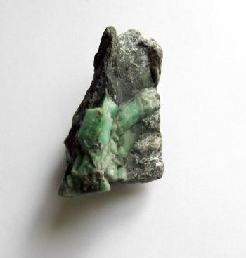 Raw uncut emerald gemstone