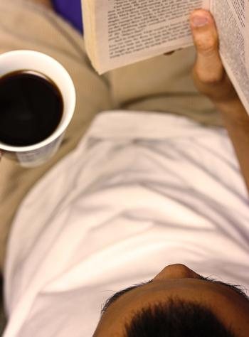 Reading A Book And Drinking A Cup Of Coffee