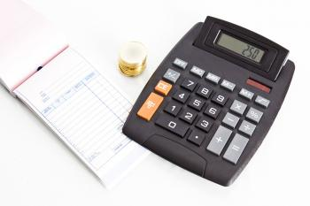 Receipt book with calculator and coins