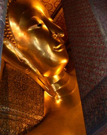 Reclining Buddha gold statue face