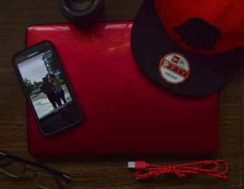 Red and Black New Era 9fifty Snapback Cap and Black Samsung Galaxy Android Smartphone