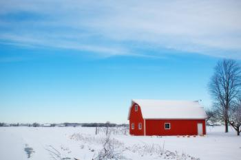 Red Barn House in the Middle of Snow Field During Daytime
