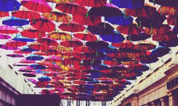 Red, Blue, and Orange Umbrella Lot