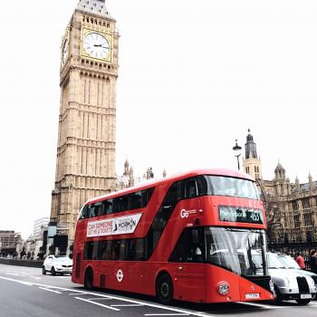 Red Bus on Road Near Big Ben in London