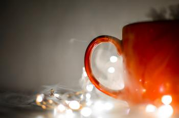 Red Mug Beside String Lights