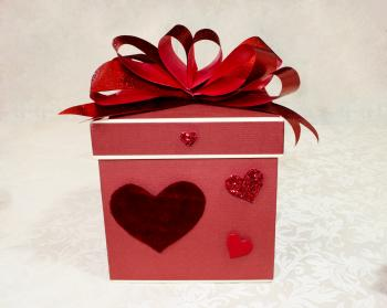 Red ribbon bow on a gift box