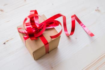 Red Ribbon on Brown Cardboard Box