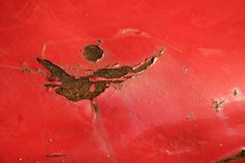 Red rusted metal plate