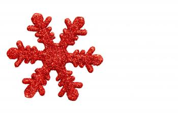 Red snowflake shaped Christmas ornament