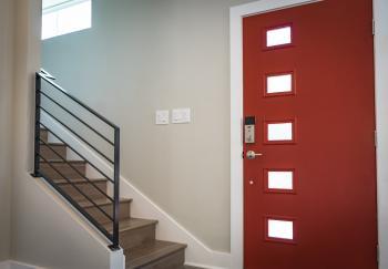 Red Wooden Door Beside Stairs