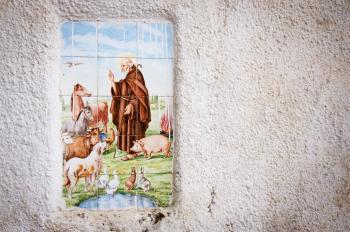 Religious tiles in street of italy