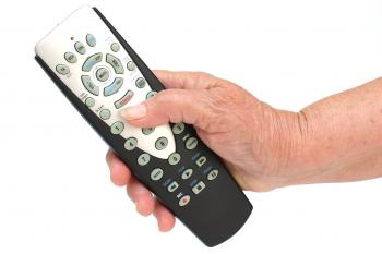 remote control in hand isolated