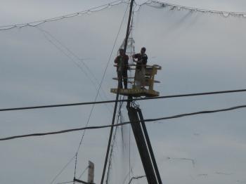 Repairing a net at a golf driving range -d.jpg