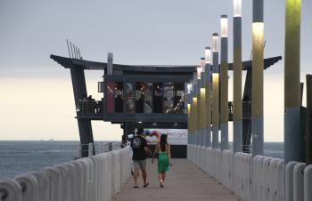 Restaurant on the pier and walking couple