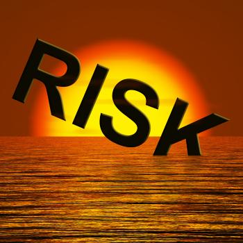 Risk Word Sinking In The Sea Showing Uncertainty