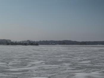 River covered with a thick layer of ice