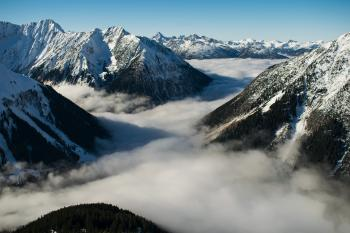 Rocky Mountain With Fog in Daytime Photo