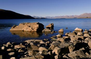 Rocky shore. Lake Tekapo. NZ