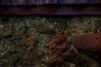 Rust stained concrete wall