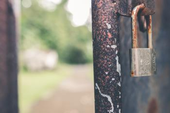 Rusted Grey Padlock in Selective-focus Photography
