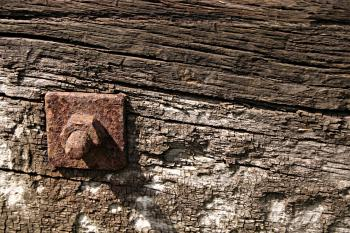 Rusted metal bolt in wood