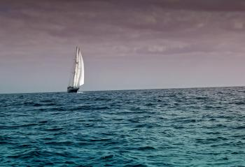 Sail Boat Under Dark Skies