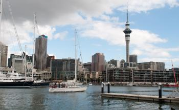 Sailboat in Viaduct Harbour in front of Sky Tower