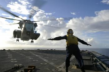 Sailor Directing Helicopter