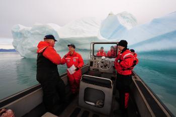 Sailors near a Giant Iceberg