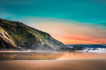 Scenic View of Beach During Dawn