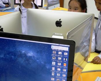 School students using Apple Macs