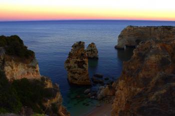 Sea stacks and sandstone cliffs at dusk