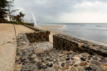 Sea wall at the SO Sofitel Hua Hin resort on Cha-am beach, Thailand.