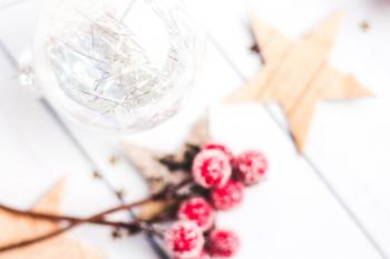 Selective Focus Photo of Clear Bauble Seeing Red Mistletoe